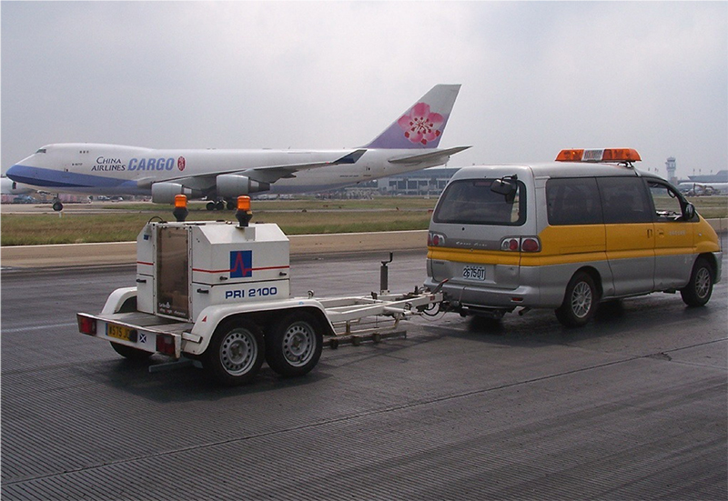 truck and plane on runway