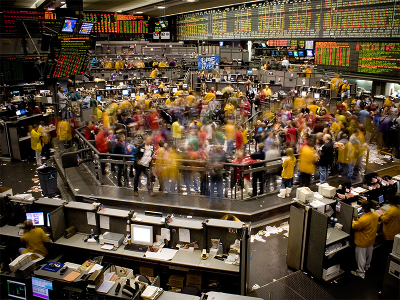 NY stock exchange floor in a flurry of activity