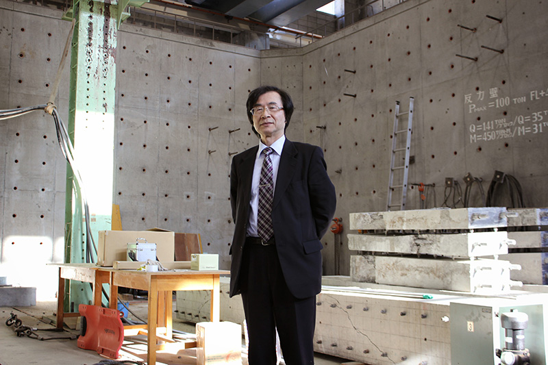 Maruyama standing in concrete walled room