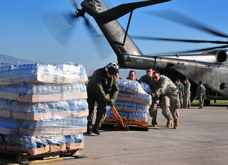 loading supplies onto a helicopter